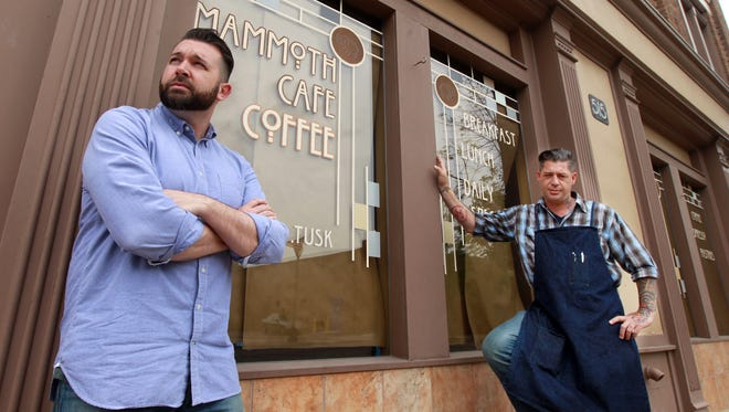 Owner Chad Reynolds, left, and executive chef Matt Cranert outside Mammoth Café in Newport, which has closed for now. They plan to transform the space into an American-craft dining spot that serves small-plate dinners.  The Enquirer/Patrick Reddy KY MAMMOTH KY JUNE 14, 2014  Chad Reynolds (left), owner, and Matt Cranert , executive chef, outside Mammoth Cafe, Newport, which  has closed.  They plan to open dining spot.