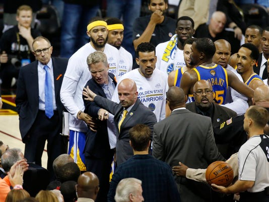 Golden State Warriors coach Steve Kerr points to a fan in the audience during a timeout in the second half of Game 4 of the basketball team's NBA Finals against the Cleveland Cavaliers in Cleveland, Friday, June 9, 2017. (AP Photo/Ron Schwane)