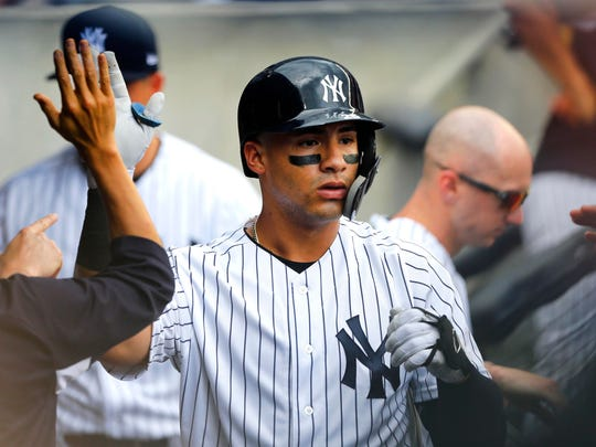 New York Yankees second baseman Gleyber Torres (25) is congratulated after hitting a home run against Baltimore Orioles at Yankee Stadium.