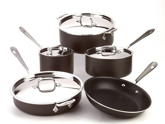9 Piece Set All Clad pots and pans.