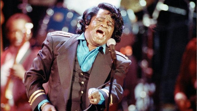 "Gospel-soul singer James Brown sings ""Living in America"" during his three-hour concert at the Wiltern Theater in Los Angeles, Ca., on June 10, 1991. The concert, titled ""Living in America,"" is broadcast as a pay-per-view show on cable television. Brown, the ""Godfather of Soul,"" died early Monday, Dec. 25, 2006. He was 73."