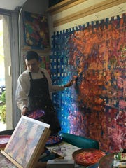 NIcholas Kontaxis works on his art inside his Rancho