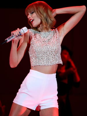 Taylor Swift performs onstage during CBS Radio's We Can Survive at the Hollywood Bowl on October 24, 2014 in Los Angeles, California.
