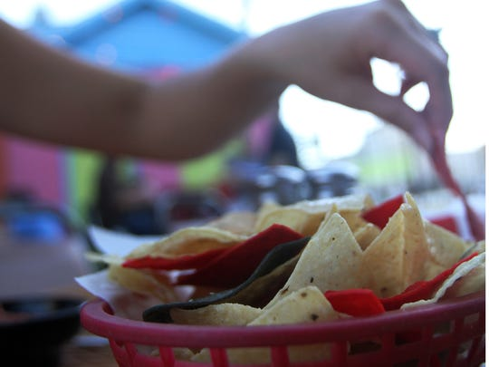 Local businesswoman Julie Calzone considers the chips, queso and margaritas from Agave as one of her guilty food pleasures.