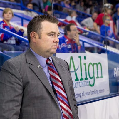 Cam Ellsworth stands behind the bench during his time