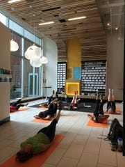 BANKS AS STORES: A yoga class at an Umpqua Bank branch.