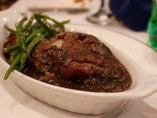 Coq au vin brings comfort to the table with a side of haricots vert.