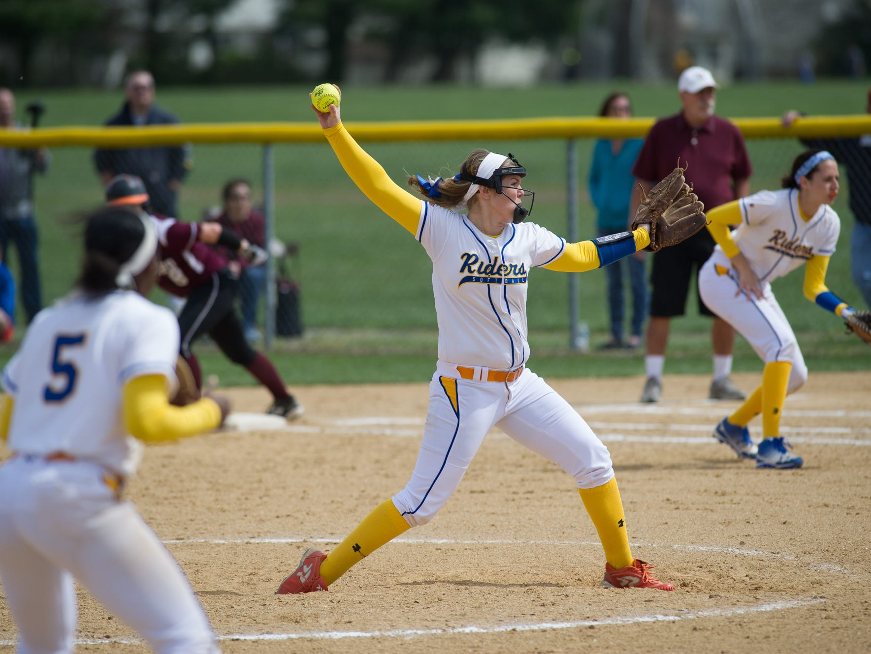 Caesar Rodney's pitcher Alyssa Ball (9) throws a pitch in their game against Concord.