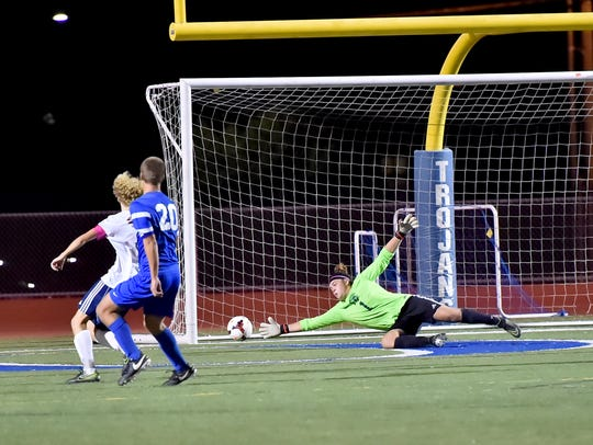 Chambersburg's goalie Jacob Dougal dives to save the