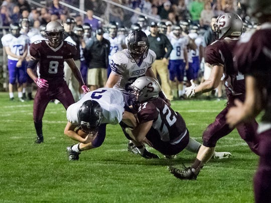 Greyhound defense Cameron Tinner (27) sacks Mifflin