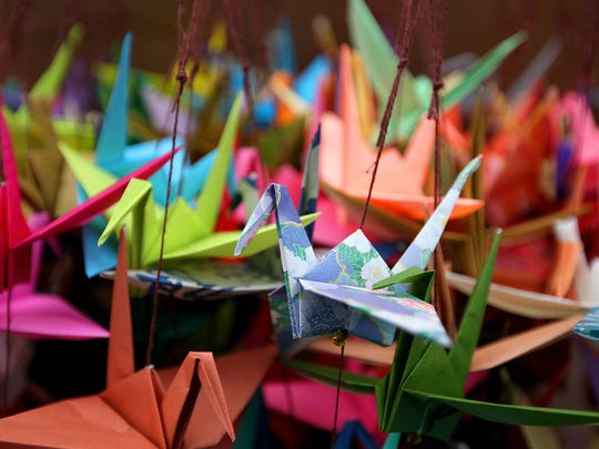 Origami cranes to be hung along the wall await visitors Thursday at the Bainbridge Island Japanese American Exclusion Memorial.