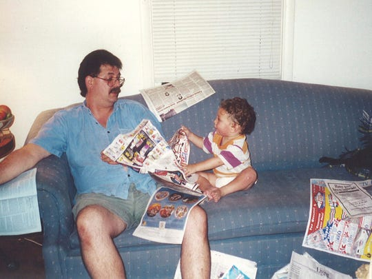 This 1995 photo provided by Jill Rovitzky Black shows Deven Black with his son, Jonas, at their home in Nyack, N.Y. The path that took Black from suburban New York dad and nationally-recognized school librarian to a room in a gritty homeless shelter - and to a bloody death at the hands of his roommate - was as baffling as it was tragic.