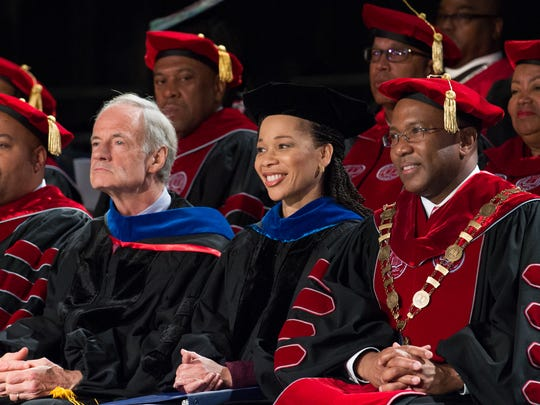 Delaware Rep. Lisa Blunt Rochester smiles as her father, Ted Blunt, introduces her before give the commencement address at Delaware State University. A total of 649 students graduated.