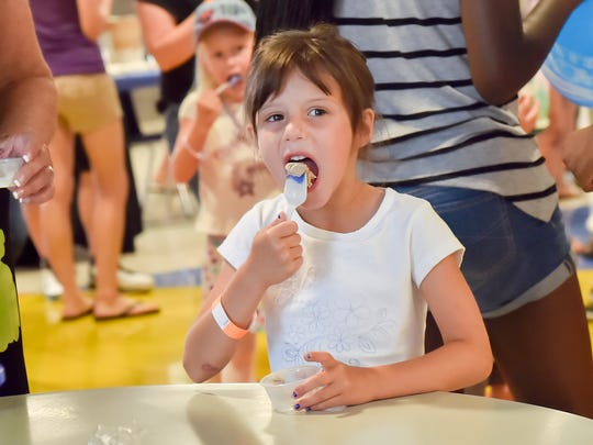 Finley Fisher takes a bite of her ice cream during ChambersFest: Scoop-a-palooza on Saturday, July 9, 2016 at Chambersburg Area Senior High School.