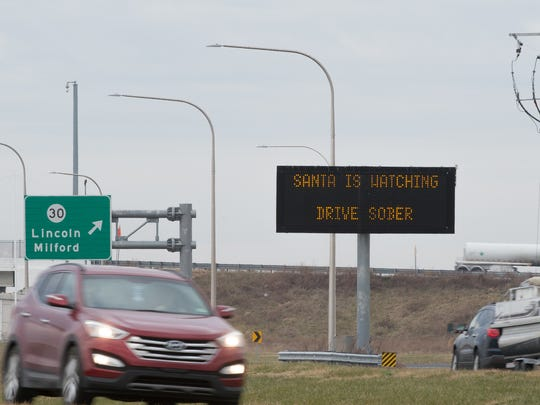 Drivers pass an electronic DelDOT sign, with a reference to santa, along Delaware Route 1 south of Milford.