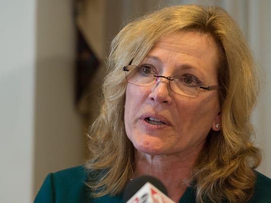 Rita Landgraf, advisory board member, speaks at an atTAcK Addiction press conference at Legislative Hall in Dover.
