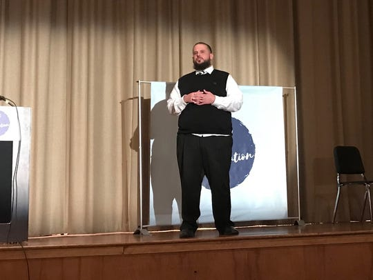Nicholas Beam, a patient navigator for the RWJ Barnabas Health Institute for Prevention, speaks to about 73 people gathered for a discussion of opioid abuse at Bloomfield Middle School on Tuesday.