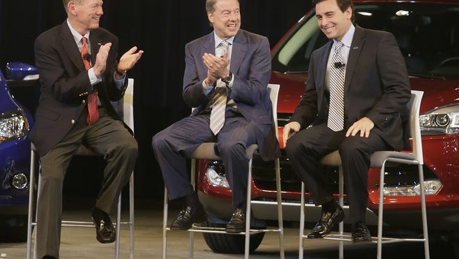 Announcement in May 2014 that Alan Mulally would retire as Ford CEO on July 1, 2014, to be replaced by Mark Fields (right). Executive Chairman Bill Ford is in center.