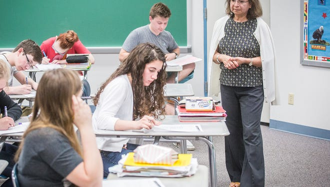 Lourdes Davis-Gordon leads students in a lesson during her Spanish class at Delta High School Tuesday afternoon. Davis-Gordon was named Minority Teacher of the Year.