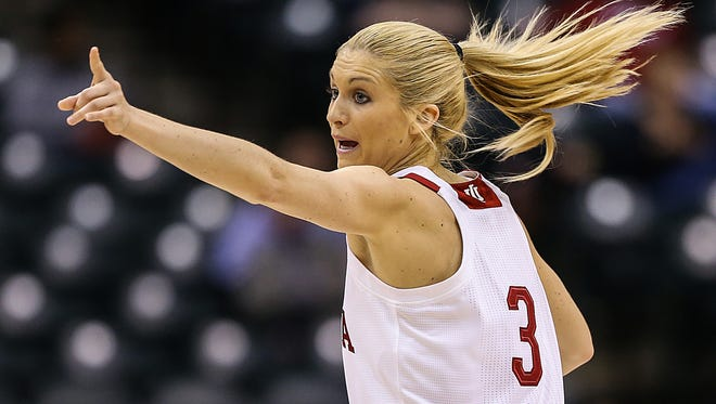 FILE -- Indiana Hoosiers guard Tyra Buss (3) signals to teammates during first half action between Indiana and Purdue in the Big Ten women's basketball tournament at Banker's Life Fieldhouse, Indianapolis, Friday afternoon, March 3, 2017.