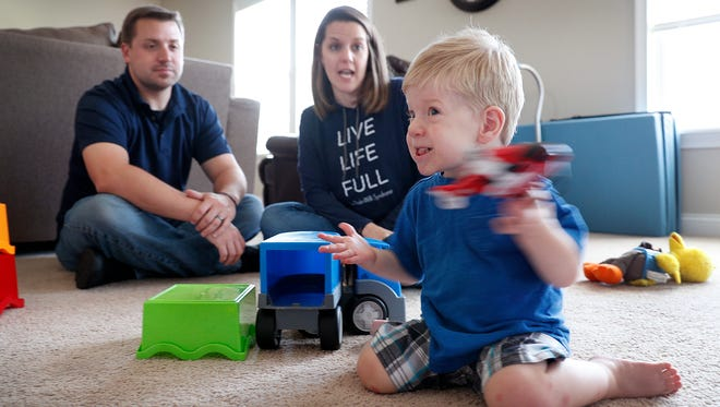 Blake and Natalie Brenneman play with their 20-month-old son Evan, who has a rare genetic disorder called Prader-Willi syndrome at their home in Plainfield Tuesday, September 5, 2017. In newborns Prader-Willi syndrome symptoms include weak muscles, poor feeding, and slow development.