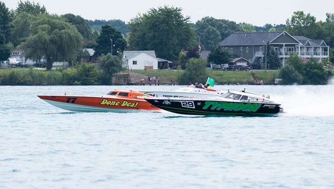 The Typhoon (right) passes the Done Deal during the Super Vee Lite race Sunday, July 29, 2018 during the Offshore Powerboat races in St. Clair.