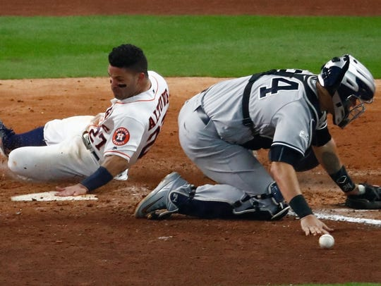 Houston Astros' Jose Altuve scores the game-winning
