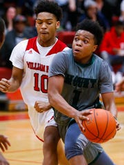 Mount Pleasant's Fah'Mir Ali drives in front of William Penn's Gerrad Wall in the second half of Mount Pleasant's 55-45 win at William Penn Tuesday.