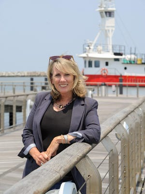 Rosemary Carroll, in front of the Kathleen docked at the Cape May Lewes Ferry, is trying to create a maritime school.