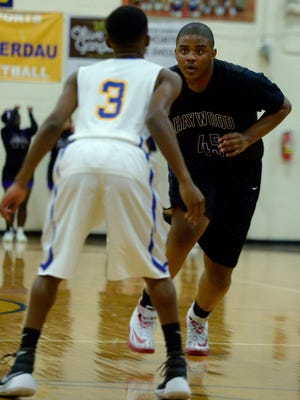 Haywood County's Dillan Dancy is guarded by North Side's Jamal Winston during their game Tuesday evening.