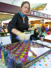 Master artist Teresa Hays, of Franklin, is a textile artist specializing in hand-dyed and marbled printed clothing and accessories.