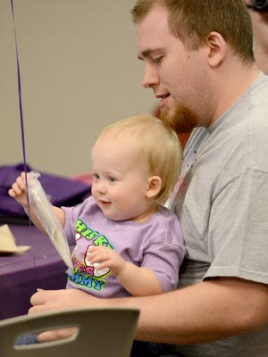 Justin Conder holds his daughter Adelynn during the March of Dimes' March for Babies kickoff on Thursday.