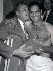 Lions QB Bobby Layne, left, who broke his ankle prior to the game, hugs QB Tobin Rote after the Lions beat the 49ers 31-27 in the Western Conference championship in this Dec. 22, 1957 photo in San Francisco. Detroit then beat the Browns 59-14 in the NFL Championship at Tiger Stadium.