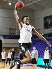 Florida SouthWestern State College's ShanQuan Hemphill scores during practice on Friday at the Suncoast Credit Union Arena in south Fort Myers. FSW will play in the second round of the National Junior College Athletic Association Division 1 Championship Tournament on March 21 in Hutchinson, Kansas.
