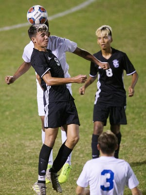 Mariner High School forward Leo Perez heads a pass against Cape Coral during the District 3A-13 soccer championship game at Mariner High School in Cape Coral.