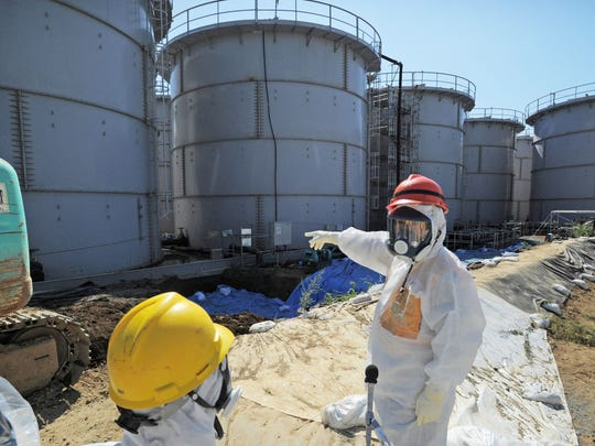 Japanese Trade Minister Toshimitsu Motegi (right) inspects storage tanks at the Fukushima Dai-ichi nuclear plant in  northern Japan on Aug. 26, 2013. Japanese Trade Minister Toshimitsu Motegi inspects storage tanks Aug.26 at the Fukushima Dai-ichi nuclear plant at Okuma, Fukushima prefecture, Japan.