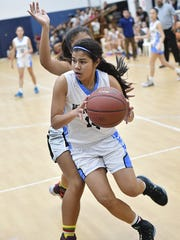 St. Paul Christian Warriors' Joylyn Pangilinan is seen taking the ball to the basket in this PDN file photo. Pangilinan scored 28 points to lead the Warriors to a 48-28 victory over the GW Geckos on Dec. 12 to advance her team to the final four of the IIAAG playoffs.