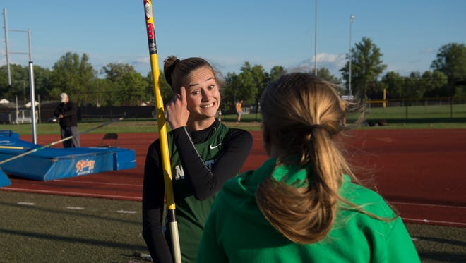 """North's Claudia Eder prepares to clear 9'6"""" to win the pole vault at the City track and field meet at Central High School Friday evening."""