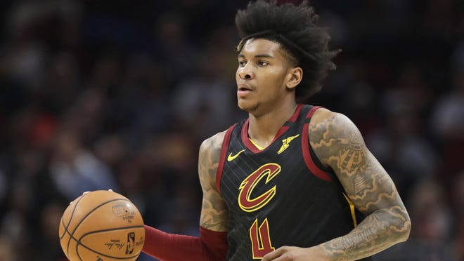 The Cavaliers' Kevin Porter Jr. moves the ball against the Philadelphia 76ers in the first half of a game on Feb. 26.