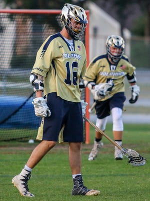 Gulf Breeze's Tucker Smith (16) reacts after scoring against Oak Hall (Gainesville) in the Region 1 semifinal game at Gulf Breeze High School on Tuesday, May 1, 2018.