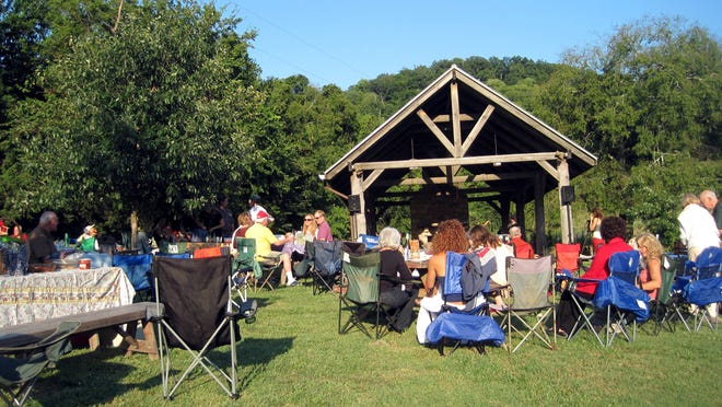 People pack picnics and settle in for Music in the Meadow at Owl's Hill in the Grassland community.