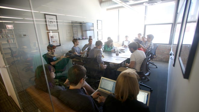 Writers gather for a headline meeting in The Onion newsroom in Chicago, on Sept. 26, 2013.