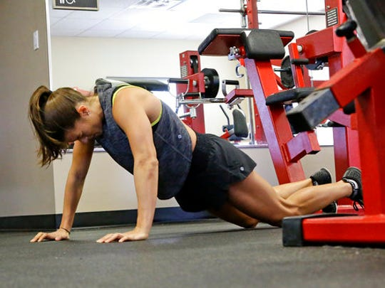 In this Saturday, Feb. 18, 2017 photo, Danica Patrick works out at Daytona International Speedway, in Daytona Beach, Fla. With Danica Patrick's auto racing career possibly nearing an end in the not-too-distant future, what might have seemed like an off-track hobby in the health and fitness world is being fast-tracked into something far bigger.