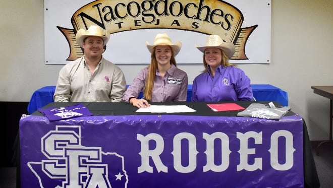 SFA assistant rodeo coach Cliff Clark, Calvary graduate Laramie Johnson and SFA head rodeo coach Rachel Clark pose recently at the Nacogdoches County Chamber of Commerce.