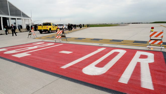 Signage directs planes to Chicago O'Hare International Airport's newest parallel runway on Oct. 15, 2015.