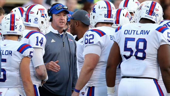 Louisiana Tech Bulldogs head coach Skip Holtz talks to his players in the second quarter of their game against the Southern Miss Golden Eagles at M.M. Roberts Stadium. Mandatory Credit: Chuck Cook-USA TODAY Sports