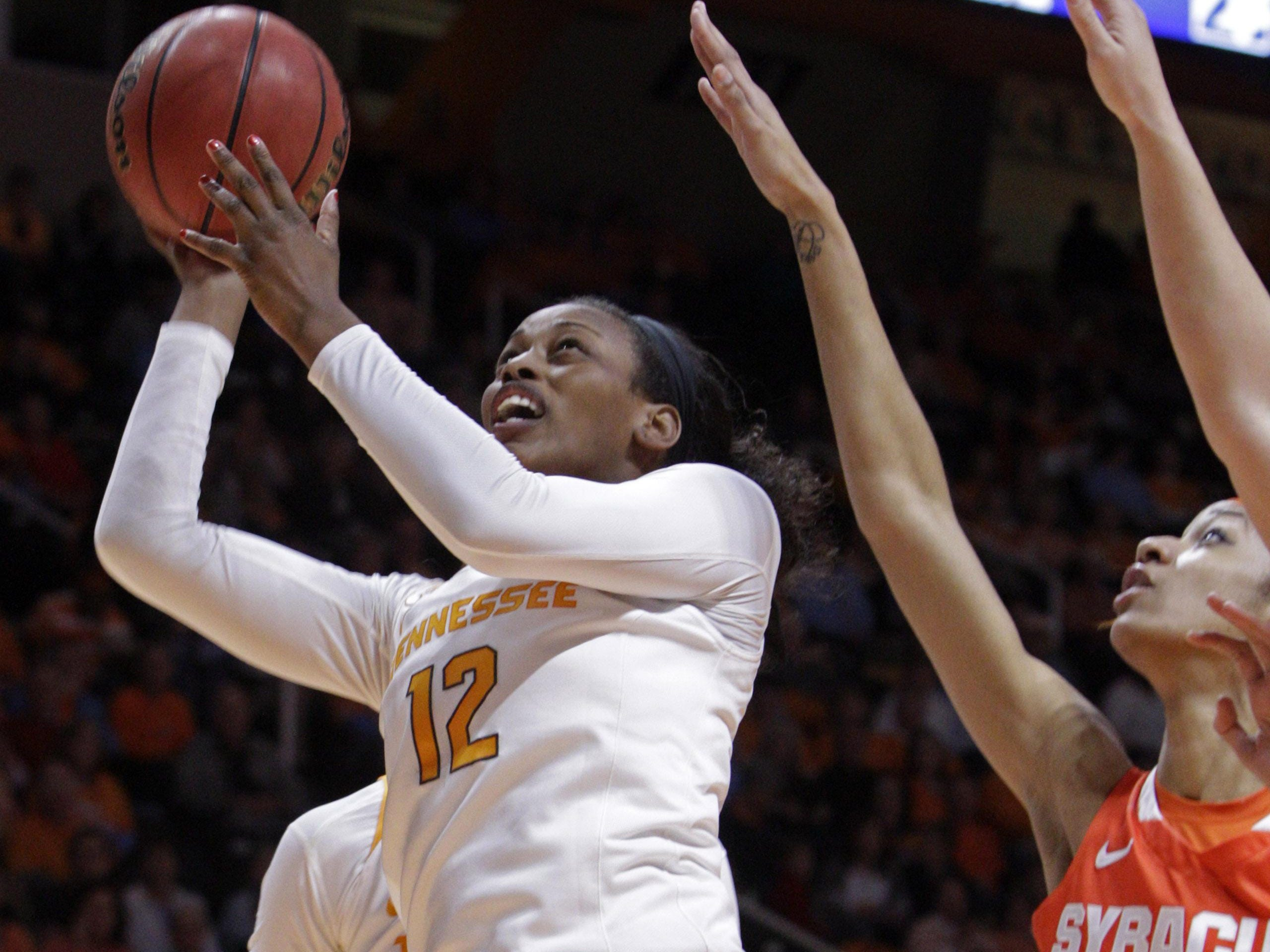Tennessee forward Bashaara Graves (12) shoots past Syracuse center Briana Day (50) in the first half Friday.