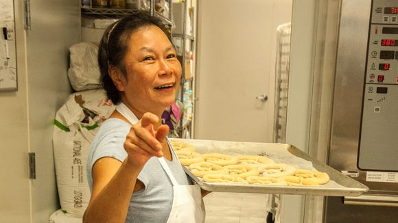 Baker Hanh Krischkowski gestures in the kitchen at ZuHause Bakery on Johnston Street on Lafayette's south side.