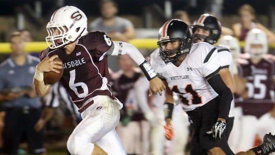 Scarsdale quarterback Barry Klein breaks free for a