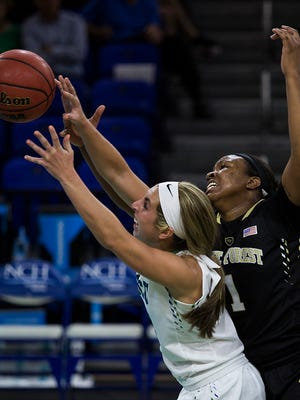 Wake Forest's Destini Walker and FGCU's Stephanie Haas fight for a rebound during their game Monday evening a Alico Arena.